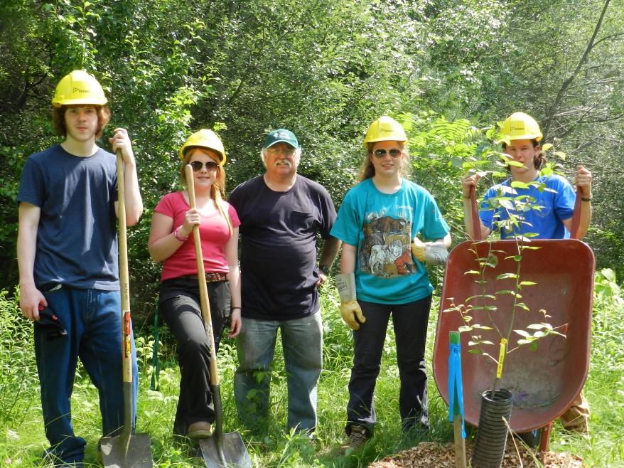 Ontario Stewardship Rangers Luke Horton, Addison Lemkay, Nichola Yaraskavitch, and Rory Whalen help Robin Cunningham plant and maintain trees at the new PRF Arboretum, July, 2013.